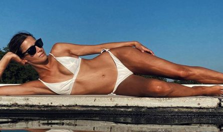 Benedetta Porcaroli white swimsuit bu the pool
