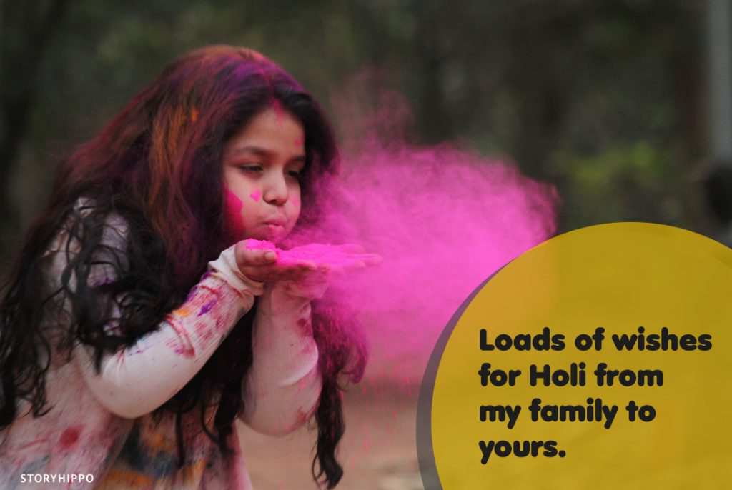 Little girl blowing holi colors