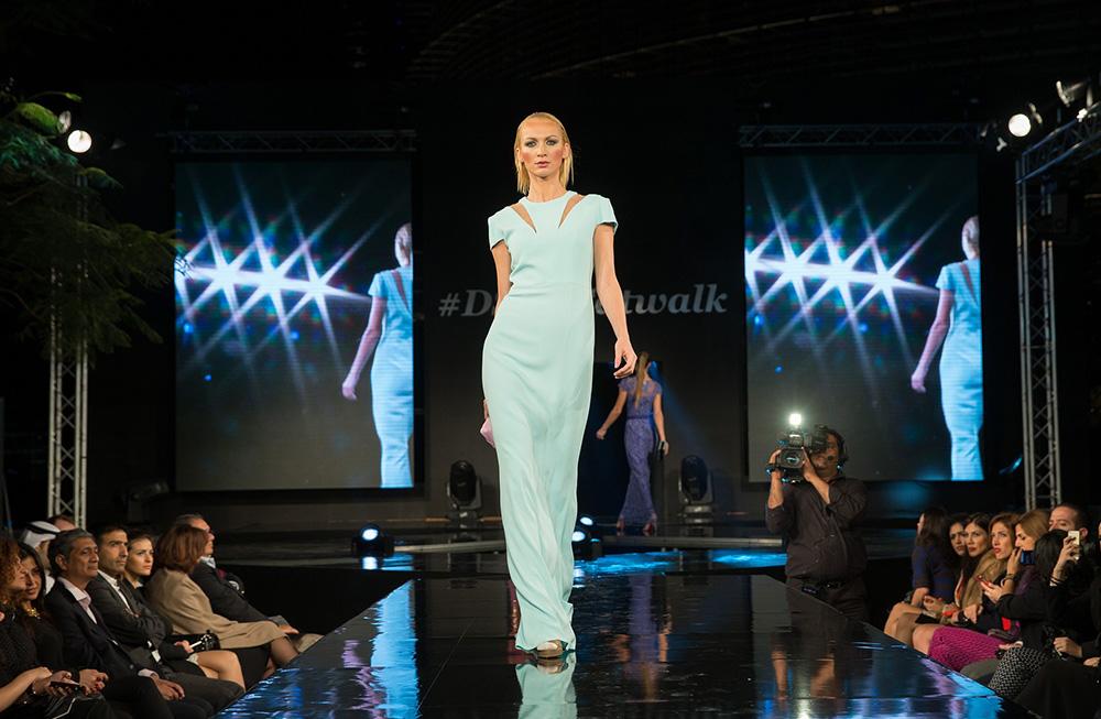 confident catwalk model on the ramp long dress