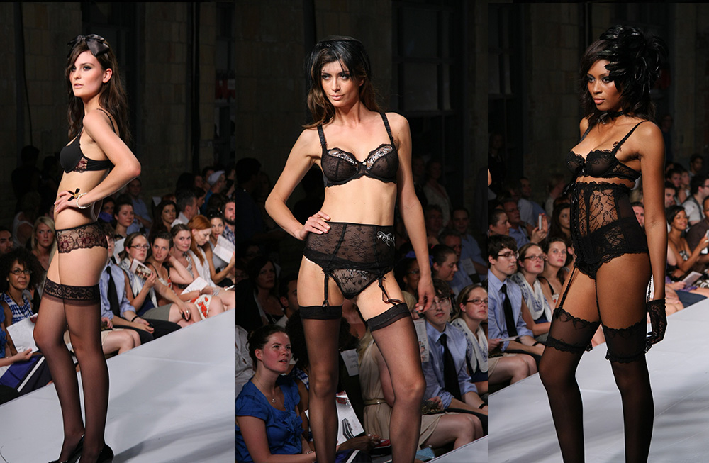 models in black lingerie catwalk on the ramp