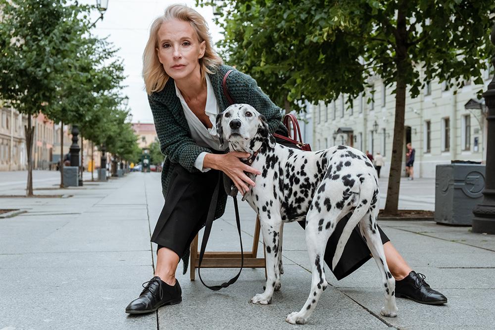 senior mature old female posing model with dog