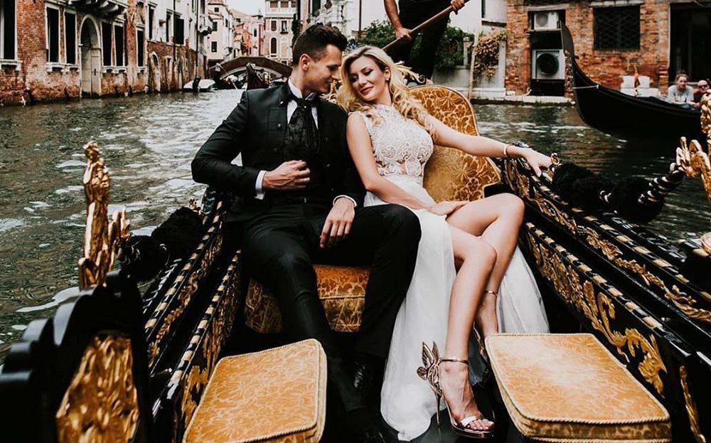 romantic couple honeymoon canal boat ride Venice