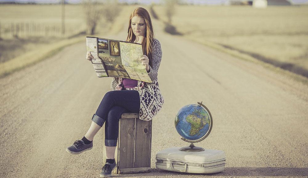 travel around the world lady with globe